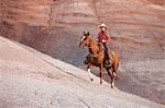 Cow-Girl de cheval dans les Badlands, Wyoming, USA