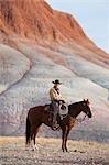 Cowboy zu Pferd in Badlands, Wyoming, USA