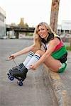 Woman Tying Roller Skate Laces, Portland, Oregon, USA