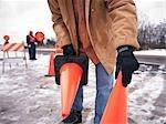 Construction Worker Placing Orange Pylons