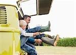 Père et fils, chausser les bottes
