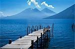 Fishing jetty on Lake Atitlan with volcanoes Toliman and Atitlan behind.