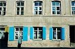 Lithuania,Vilnius. Colourful windows of an old town building - part of Vilnius Unesco World Heritage Site.