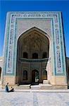 Uzbek men sit outside The Kalan Mosque. Built in 1121-22AD during the reign of the Kharakhanid ruler Arslan Khan Muhammed.