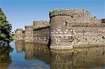 Pays de Galles. Anglesey, Beaumaris. Conçu en 1295 par James de Saint-Georges, Beaumaris Castle est l'un des plus beaux de l'anneau de fer des châteaux construire par Edward je pour imposer son autorité sur les pays de Galles.