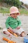 Baby Girl Playing in Sand on Beach, Near Seaside, Oregon, USA
