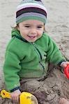 Close-up pf Baby Girl Sitting on Beach, Near Newport, Oregon, USA