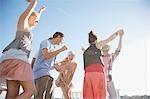 Friends dancing on rooftop