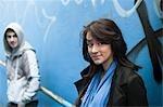 Teenagers Standing Near Graffiti Wall