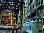 Steel Engineers Inspecting Furnace