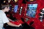 Teenage Boy Playing Arcade Game