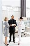 Business people talking in modern office