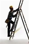 A construction worker climbing a ladder