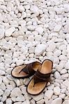 Sandals on white stones.