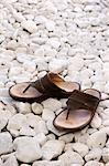 Sandals on white stones