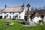 Thatched cottages on the village green in Lustleigh, Dartmoor, Devon, England UK