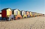Row of colorful beach huts on beach