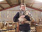 Female Farmer Holding Lamb