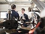 Engineer Teaching Apprentice In Workshop