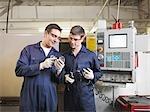 Engineer & Apprentice With CNC Machine