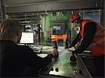 Engineers In Steel Forge Control Room