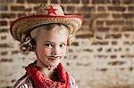 Junges Mädchen, verkleidet als cowgirl