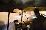Rear view of a man driving an auto rickshaw, Jaipur, Rajasthan, India