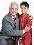 Portrait of a senior man hugging his grandson