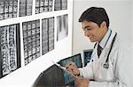 Male doctor writing a prescription