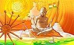 Mahatma Gandhi spinning thread on spinning wheel