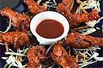 Ailes de poulet, servis avec sauce chili