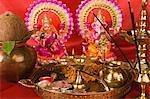 Diwali thali in front of idols of Lord Ganesha and Goddess Lakshmi