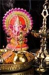Diwali thali in front of an idol of lord Ganesha