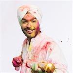 Portrait of a man playing Holi with a pichkari