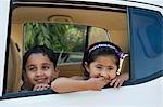 Children smiling in a car