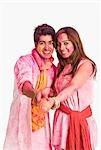 Couple playing Holi with a pichkari