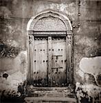 Image taken with a Holga medium format 120 film toy camera of old Omani studded timber door, Stonetown, Zanzibar, Tanzania, East Africa, Africa