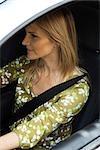 Woman driving car wearing seatbelt