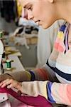 Seamstress sewing on sewing machine