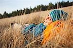 Woman Lying in Long Grass near Deschutes River, Oregon, USA