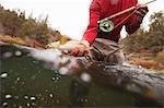Man Fly Fishing on Deschutes River, Oregon, USA