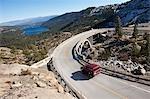 SUV Driving across Historic Bridge at Donner Summit, near Lake Tahoe, California, USA