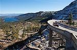 Vintage 4x4 Driving across Historic Bridge at Donner Summit, near Lake Tahoe, California, USA