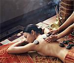 Tibetan hot stones treatment at Chi Spa, Shangrila, Bangkok, Thailand, Southeast Asia, Asia
