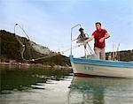 Fisherman fishing with net