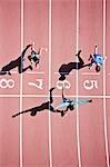 Runner crossing finishing line on track