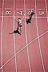 Winning runner cheering on track