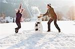 Couple making snowman