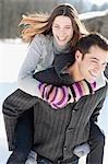 Man giving girlfriend piggyback ride