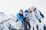 Family on snowy mountain top